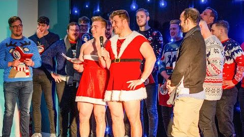 Players sing carols for charity